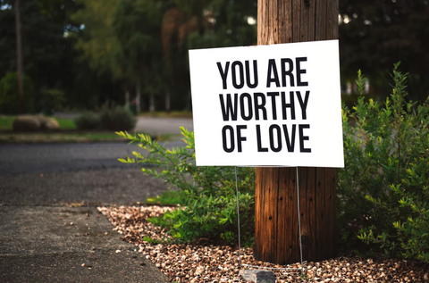sign that says worthy of love