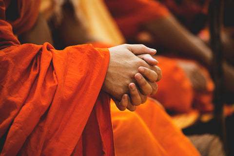 Monk clasping hands