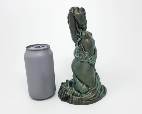 Mermaid fantasy adult toy sculpture in Deepest Wave from Lust Arts next to a silver standard soda can for scale