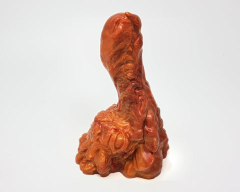 A Mosswood Dragon dildo in color Fiery Maple