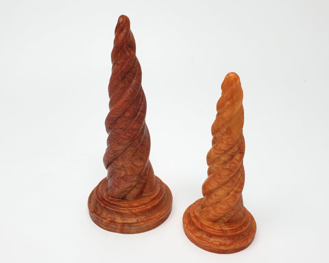 Two Unicorn Horn dildos in special event color Fiery Maple on a white background
