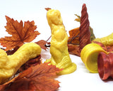 A Mosswood Dragon, Mermaid, Unicorn Horn, and a couple Double-Sided Suction Cups with silk fall maple leaves on a white background