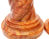 Closeup photo of the base of a Unicorn Horn dildo in special event color Fiery Maple on a white background