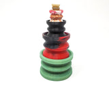 Four sizes of Double-Sided Suction Cups from Lust Arts stacked on top of each other with a charm mini suction cup on top of the stack