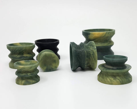 Six Double-Sided Suction Cups from Lust Arts in a deep green and pale gold color in a range of three sizes