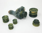 Six Double-Sided Suction Cups from Lust Arts in a deep green and pale gold color in a range of three sizes and a Mosswood Dragon with a suction cup