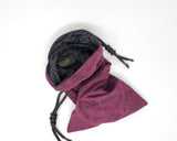 Deep purple faux microsuede fabric bag with King Noire's name embroidered, black Shibari rope drawstring on a white background