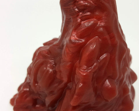 Closeup photo of the base of a Mosswood Dragon sex toy in red wine and blood marble color, Lupercalia