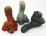Group image of all three original colors for the Mosswood Dragon fantasy-themed adult toy on a white background