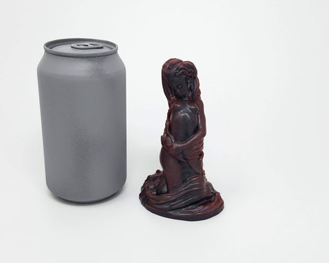 Different angles of a Mermaid dildo from Lust Arts next to a soda can for scale reference
