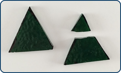 two cut sheet glass triangles