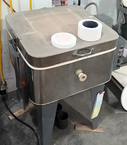 a microwave kiln on top of a traditional kiln