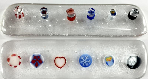 murrine capped with a clear dot and fused to sheet glass