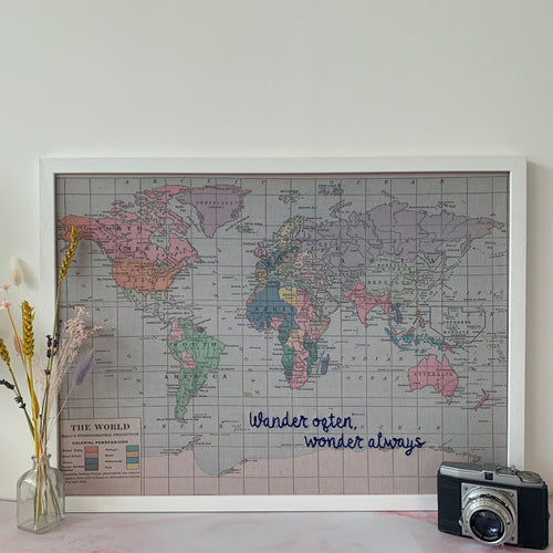 'Wander often, wonder always' embroidered map