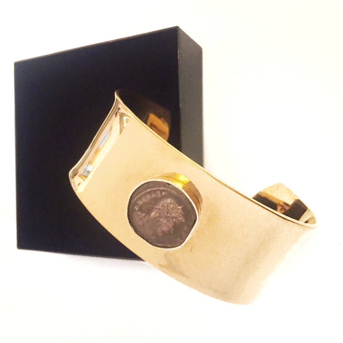 Cuff with Roman coin