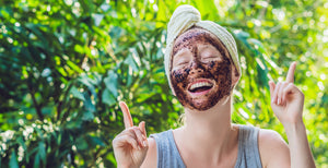 A woman with black beauty mask applied on face
