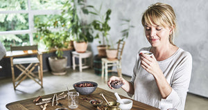 Picture of woman next to herbs on table