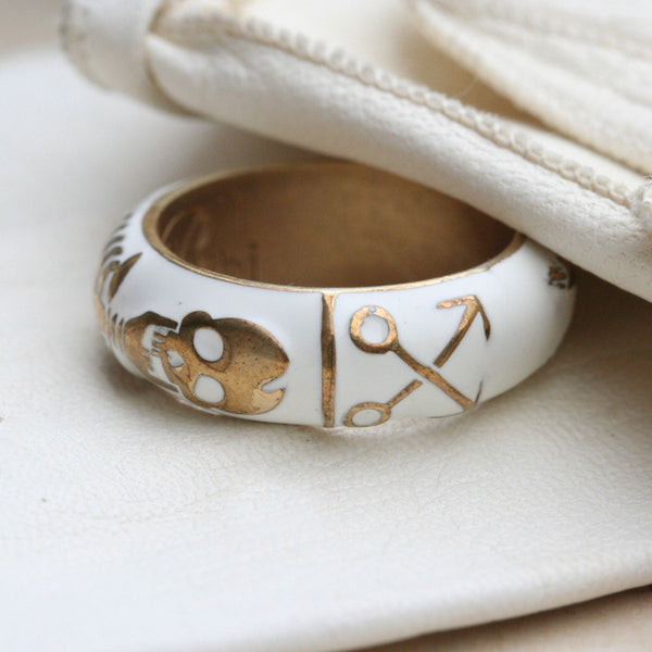 White skeleton ring gold and white enamel by Brigitte tanaka