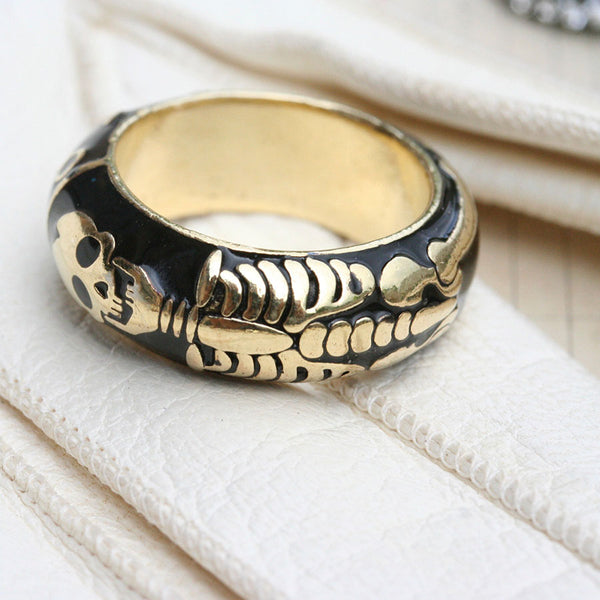 Ring gold skeleton and black enamel by Brigitte Tanaka