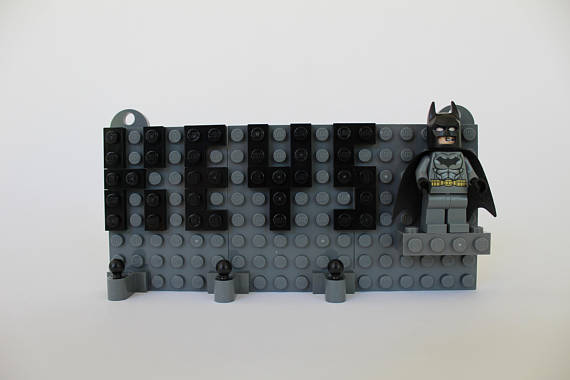 Grey Toy Brick Key Organizer with Black Letters and a Batman Minifigure