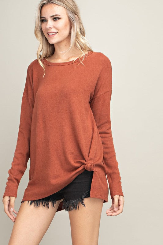 rust sweater with detailed back