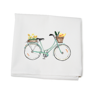 seafoam bike with daffodils on back