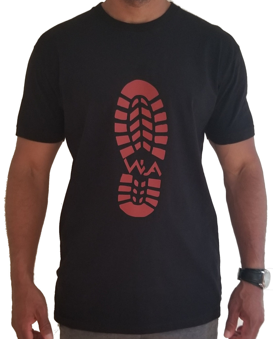 Front view of black tee with brown boot print printed on front