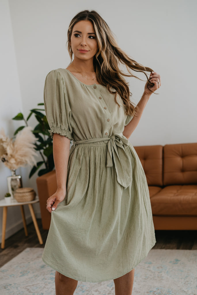 The Anselem Button Midi in Light Olive, Wren & Ivory dresses, Nursing Friendly, Baby Bump Friendly, fashion, Wren & Ivory, Wren and Ivory, balloon half sleeves, light olive green dress, midi length, self-tie belt, elastic waist, elastic cuff sleeve, round neck, modest, functional buttons, ladies dress