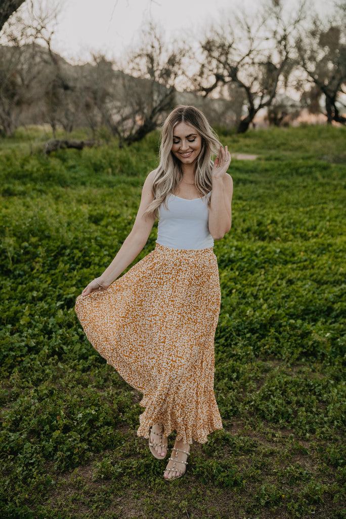 The Tyla Pleated Leopard Skirt in Marigold
