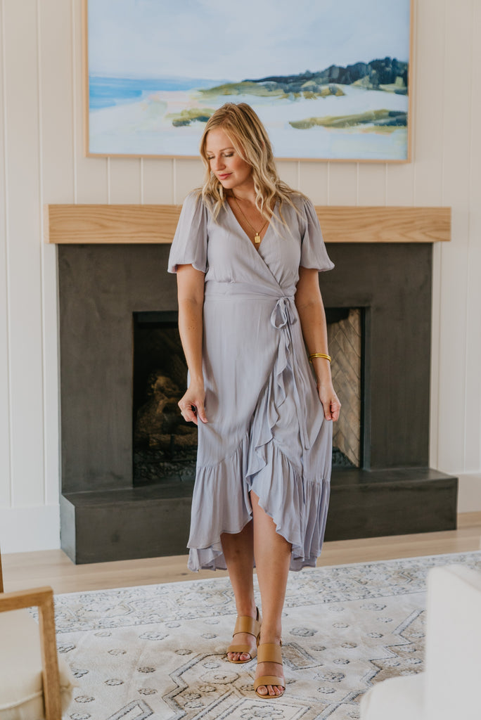 The Elayne Wrap Dress in Periwinkle, wrap dress, fashion, Wren & Ivory, Wren and Ivory, elastic cuff sleeves, solid purple dress, midi length, surplice neckline, true wrap dress, self-tie belt, lined, ruffle hem, Nursing Friendly, periwinkle color