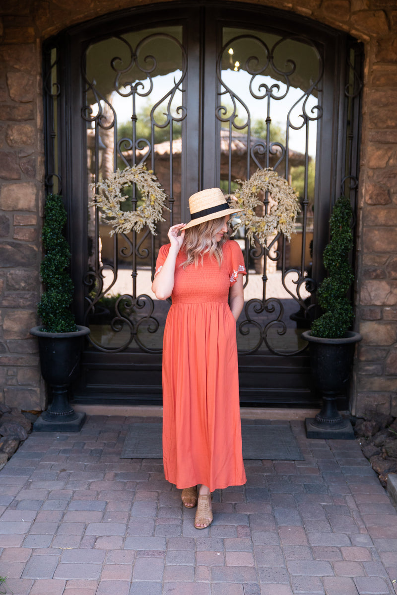 The Orion Smocked Dress in Sunset Orange