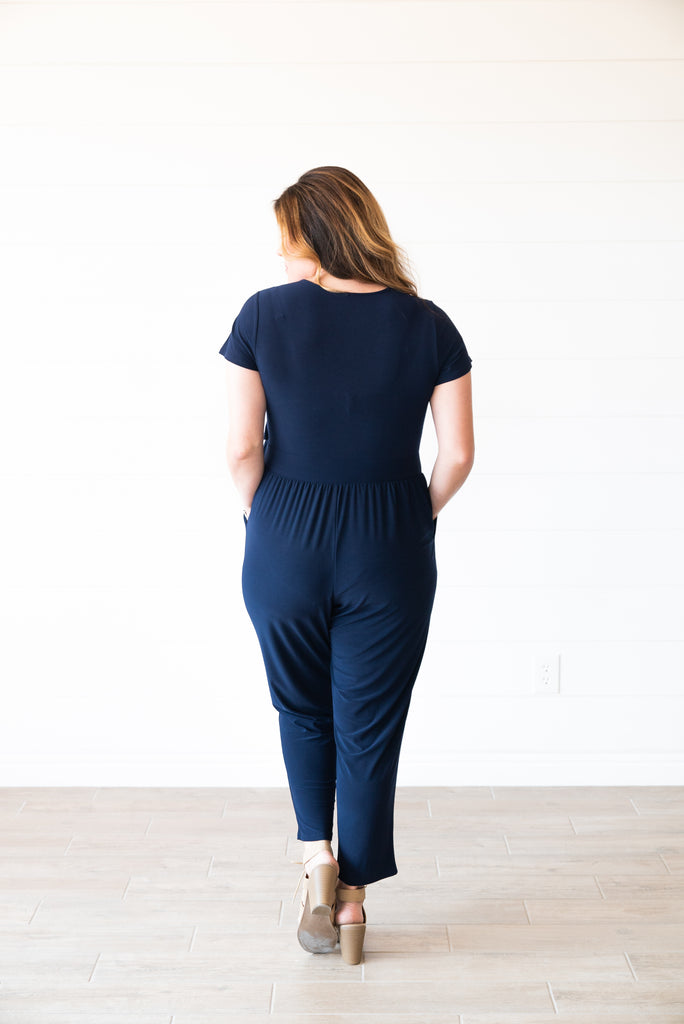 The Jett Solid Jumpsuit in Navy (Sizes 1X-3X)