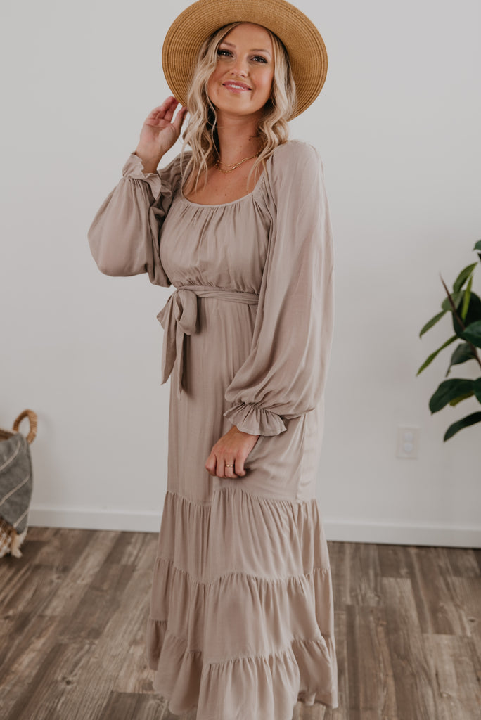 The Adrian Square Neck Maxi in Beige, Wren & Ivory dresses, fashion, Wren & Ivory, Wren and Ivory, long sleeve, lined dress, maxi length, natural dress, modest dress, square neckline, ladies dress, elastic waist with self tie belt, tiered dress, Baby Bump Friendly, Nursing Friendly, off-the-shoulder, peasant sleeves