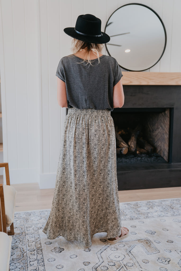 The Genoa Button Skirt in Black, maxi skirt, smocked elastic waist, drawstring tie, ivory floral print, Wren and Ivory, Wren & Ivory, casual, button detail, A-line skirt