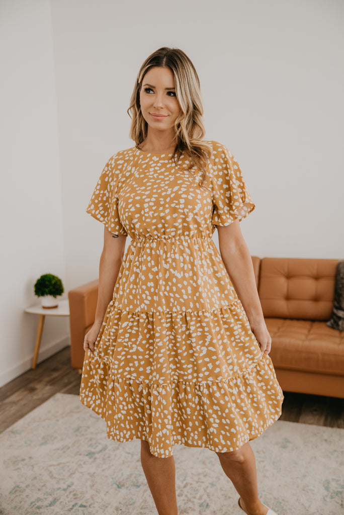 The Nelson Tiered Midi in honey, light and feminine, honey beige with white dot print, elastic waist, flutter sleeves, A-line dress, modest, mommy fashion, Baby Bump Friendly, Wren & Ivory, Wren and Ivory