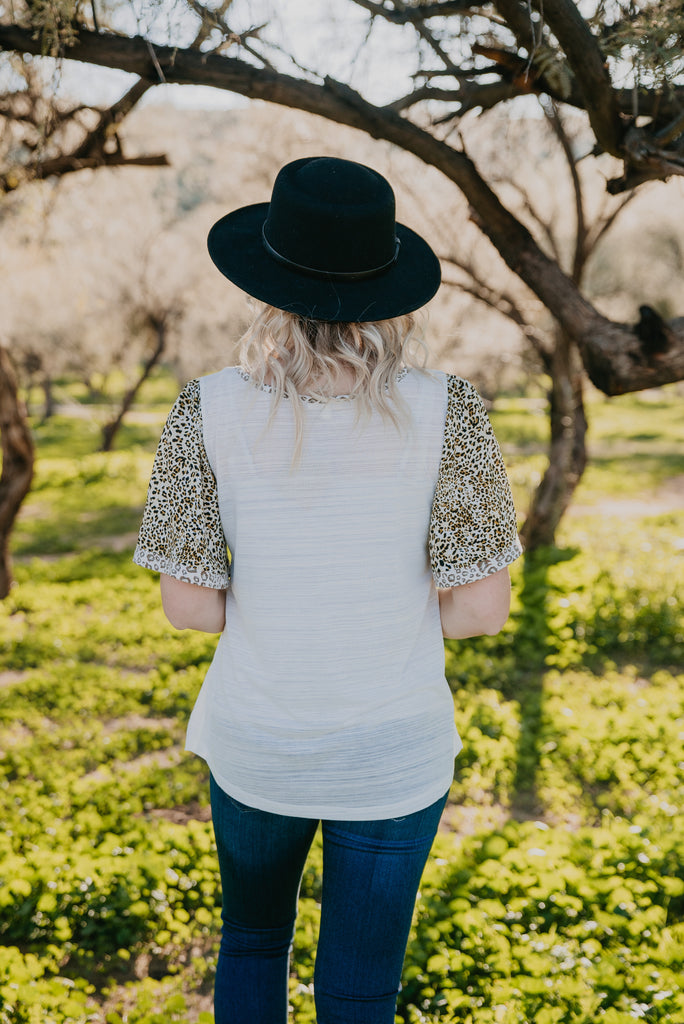 The Aldama Animal Print Raglan in Ivory