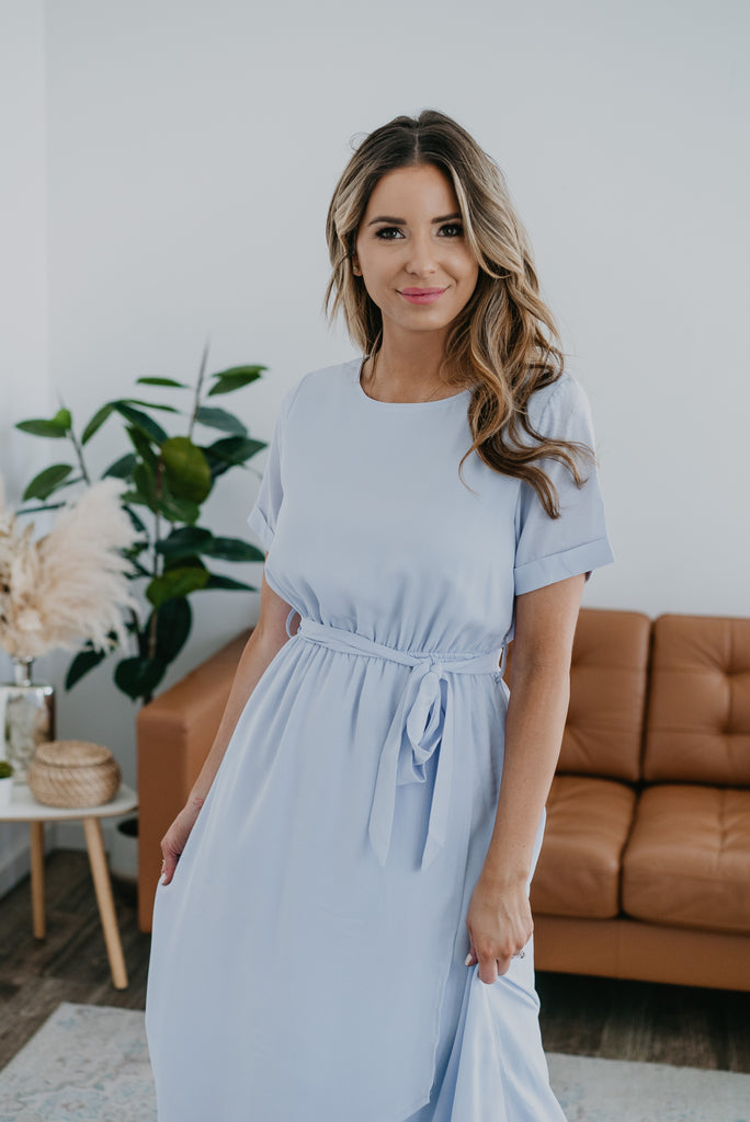 The Giselle Faux Wrap Dress in Iced Blue, Wren & Ivory dresses, fashion, Wren & Ivory, Wren and Ivory, short cuff sleeve, faux wrap dress,  maxi length, solid light blue dress, modest dress, round neckline, ladies dress, elastic waist with self tie belt, bridesmaid dress