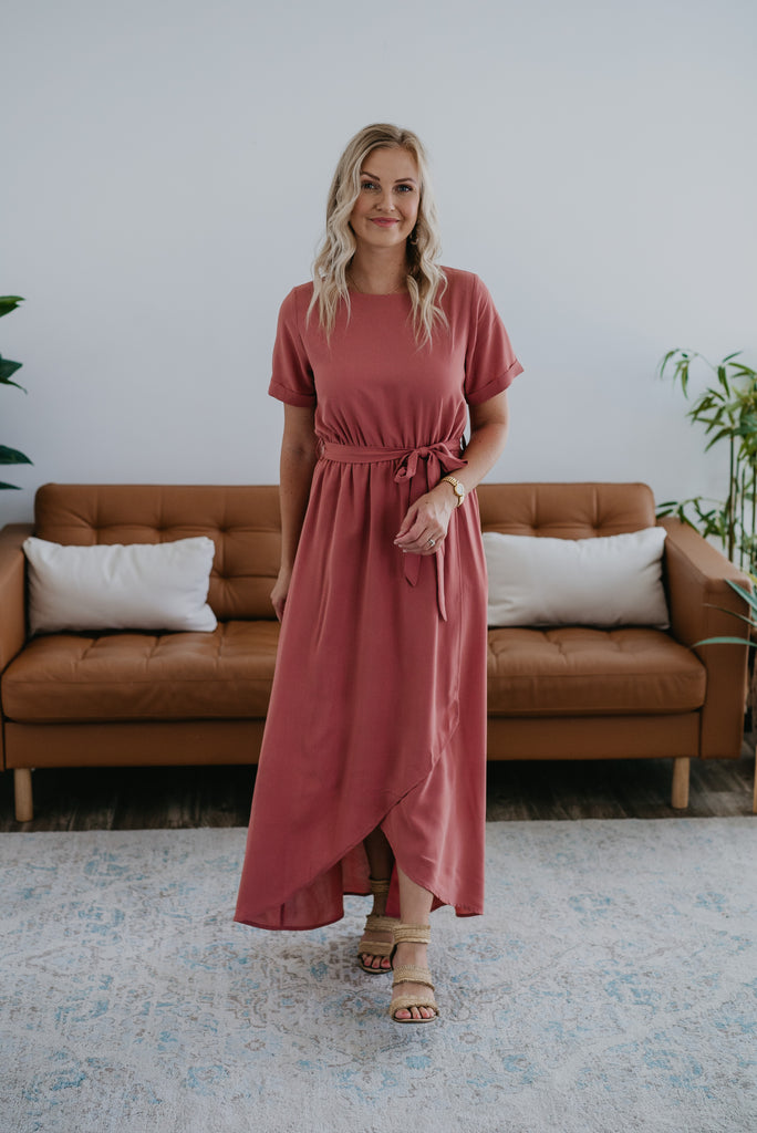 The Giselle Faux Wrap Dress in Dusty Rose, Wren & Ivory dresses, fashion, Wren & Ivory, Wren and Ivory, short cuff sleeve, faux wrap dress,  maxi length, solid rose color, modest dress, round neckline, ladies dress, elastic waist with self tie belt, bridesmaid dress