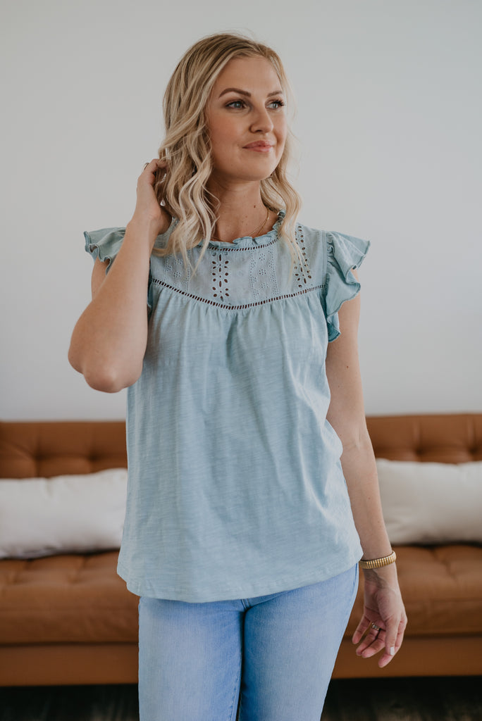 The Jolyn Ruffle Sleeve Top in Blue Sage, summer top, women fashion, Wren & Ivory, Wren and Ivory, fashion top, ruffle cap sleeve, eyelet details, embroidery, high neck, summer top, light blue top, baby bump friendly
