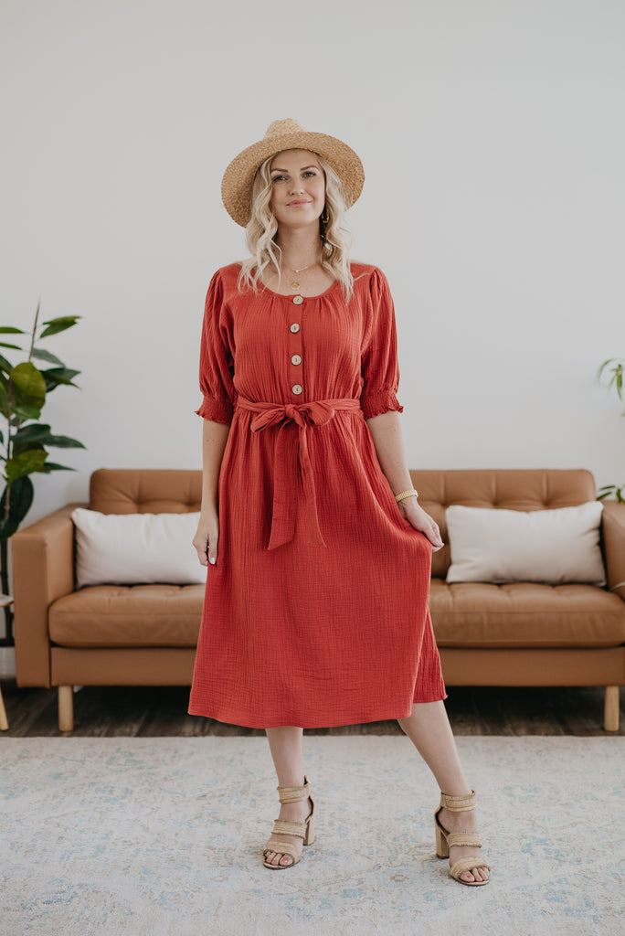 The Leandra Button Midi in Brick, midi dress, fashion, Wren & Ivory, Wren and Ivory, smocked elastic cuff sleeves, solid red dress, midi length, round neckline, functioning buttons, self-tie belt, Nursing Friendly, Baby Bump Friendly