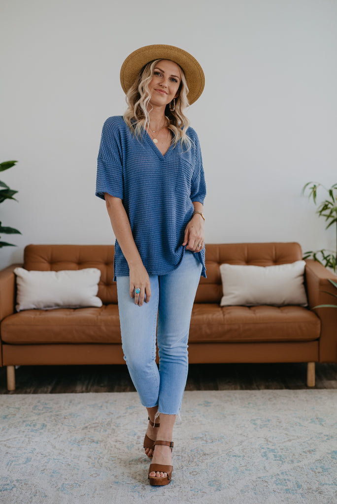 The McKenna Waffle Top in Dusty Blue, short sleeve waffle knit top, women fashion, Wren & Ivory, Wren and Ivory, fashion top, blue top, V-neck, breast pocket, tunic top, loose cut, soft knit, short sleeve top