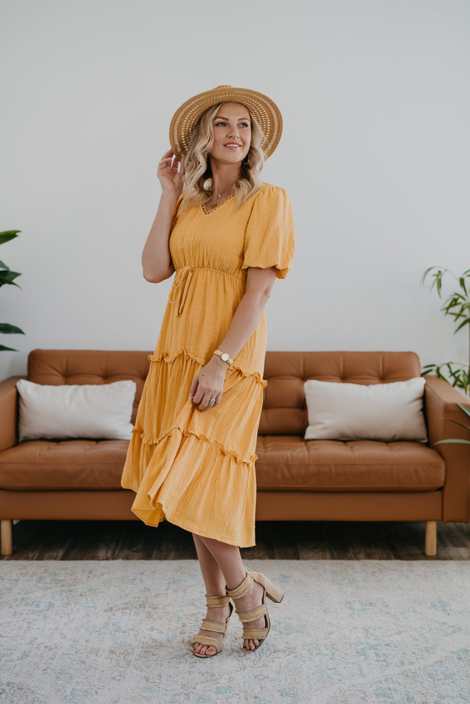 The Shalyn Tiered Midi in Mustard, Wren & Ivory dresses, Baby Bump Friendly, fashion, Wren & Ivory, Wren and Ivory, balloon half sleeves, blush dress, midi length, decorative waist tie, elastic waist, ruffle tiers, trim neck, modest, elastic waist, 100% cotton, yellow dress