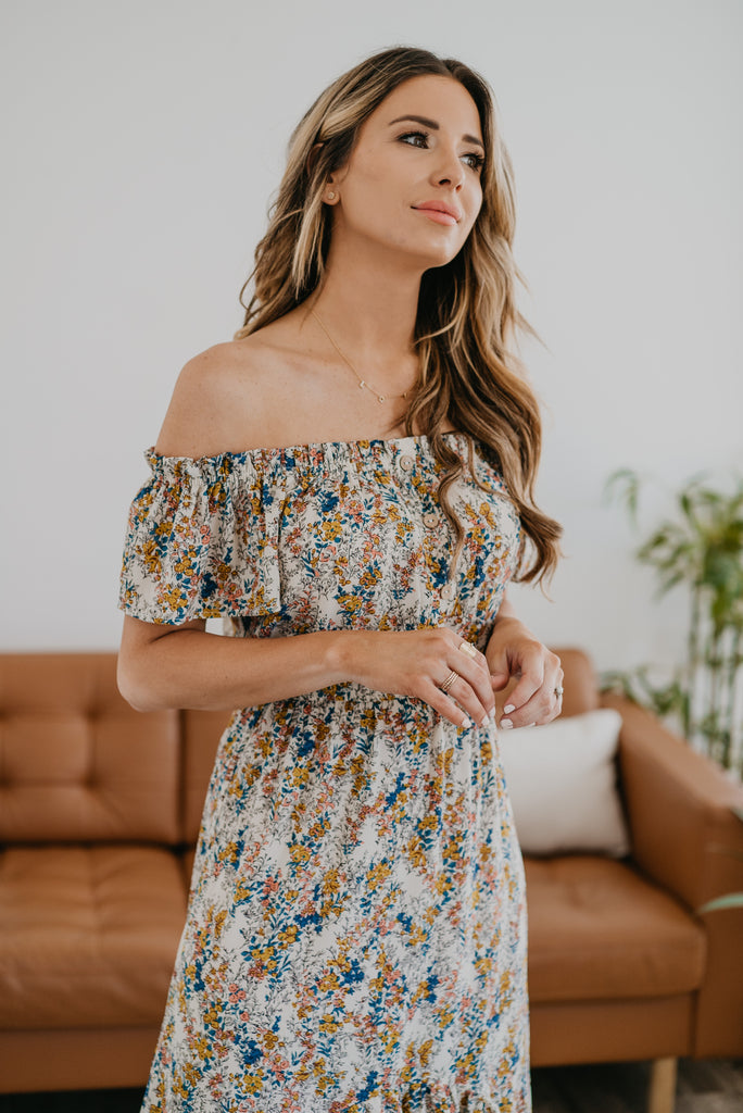 The Tamina Off-the-Shoulder Dress, Wren & Ivory dresses, fashion, Wren & Ivory, Wren and Ivory, sleeveless, hi-low dress,  maxi length, bare shoulders, floral print, off-the-shoulder dress, ladies dress, ruffle details, decorative buttons, ivory and floral dress