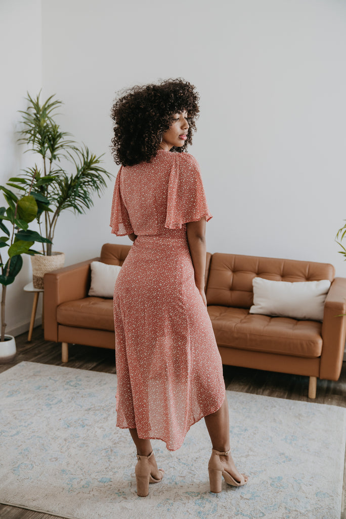 The Yasmine Wrap Midi in Dusty Rose, Wren & Ivory dress, fashion, Wren & Ivory, Wren and Ivory, flutter sleeves, rose with ivory print flowers, midi length, deep v neckline, true wrap dress,self-tie belt, lined, rounded hem, high-low wrap dress, Nursing Friendly, mauve color