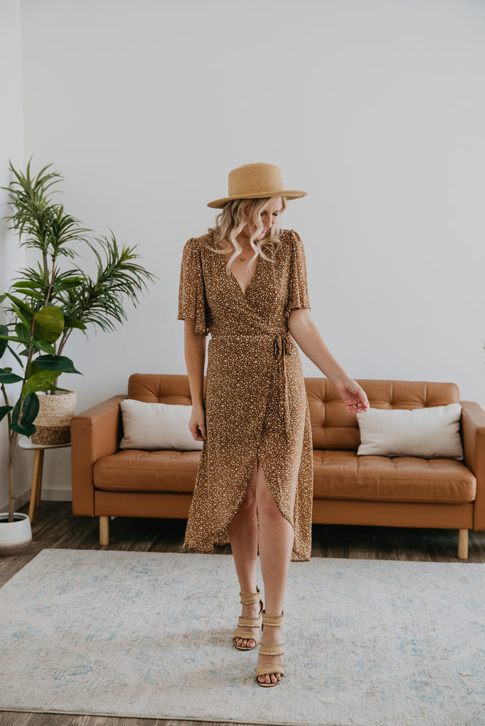 The Yasmine Wrap Midi in Caramel, Wren & Ivory dress, fashion, Wren & Ivory, Wren and Ivory, flutter sleeves, carmel with ivory print flowers, midi length, deep v neckline, true wrap dress,self-tie belt, lined, rounded hem, high-low wrap dress, Nursing Friendly