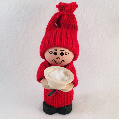 Swedish tomte holding bowl