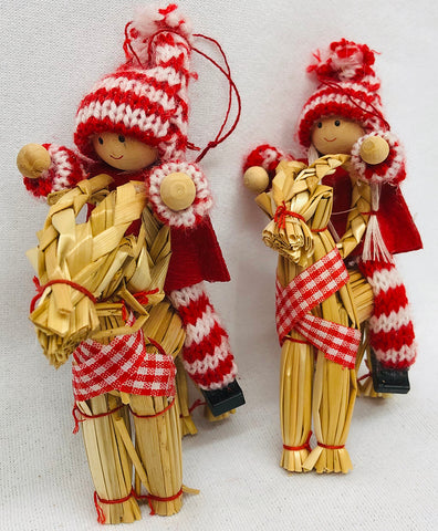 Gnomes riding straw goat ornaments pair