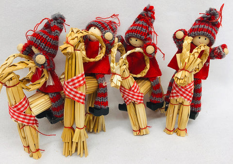 Gnomes riding straw goat ornaments - Set of 4