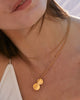 To the Moon and Back Necklace in 14k gold finish on model