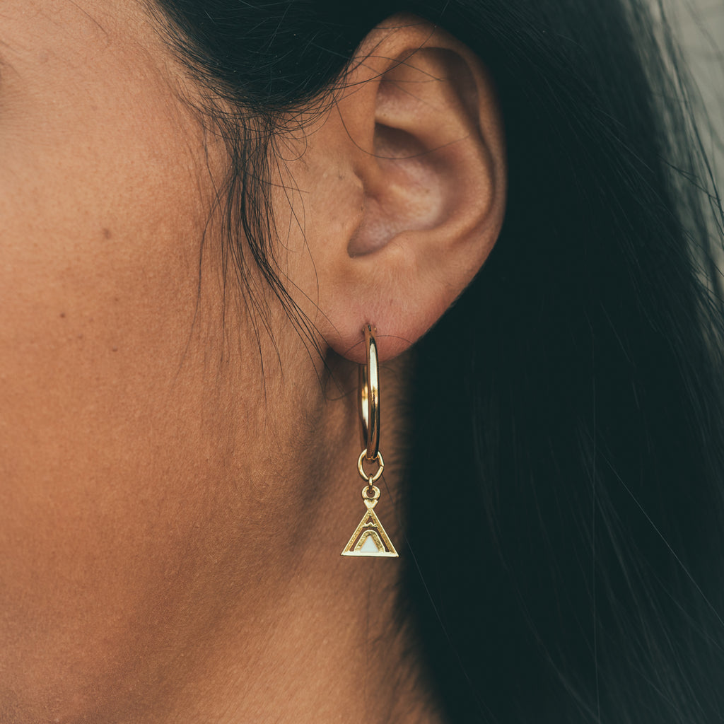 mini hoop earring base on model close up paired with tribe friendship earring charm bryan anthonys charmcollection